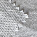 WF1 / O9TO5 SS + PTFE Ikke-vævet stof lamineret med PTFE mælkeagtig åndbar membran af medicinsk beskyttelsesdragt stof